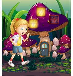 A young girl at the enchanted mushroom house vector image