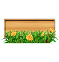 An empty signboard at the back of the plants vector image