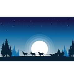 Train santa with reindeer landscape of silhouettes vector