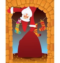 santa claus in the fireplace vector image