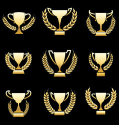 Golden winner awards with wreaths vector