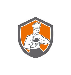 Chef cook serving chicken platter shield retro vector