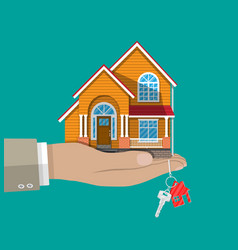 hand with small house and keys vector image vector image