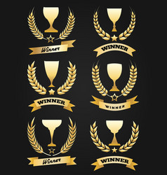 Golden winner cups with ribbon vector