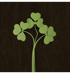 Clover leaves on wooden weathered texture vector