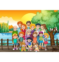 Family members standing on the bridge at sunset vector image