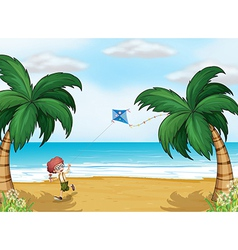 A young boy playing with his kite at the beach vector image vector image