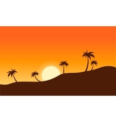 Silhouette of palm lined landscape sunset vector
