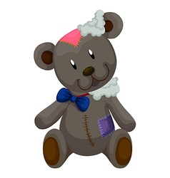 Old teddy bear with patches vector image