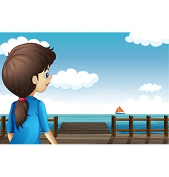 A girl watching the boat vector image vector image
