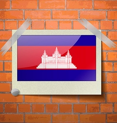 Flags cambodia scotch taped to a red brick wall vector