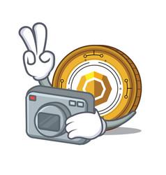 Photographer komodo coin mascot cartoon vector