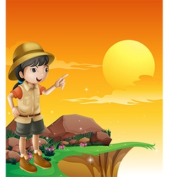 A female explorer standing near the cliff vector image
