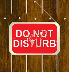 DO NOT DISTURB sign hanging on a wooden fence vector image