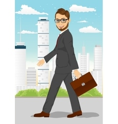 businessman walking through the city vector image vector image
