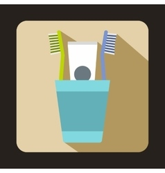 Blue plastic cup with brushes icon flat style vector