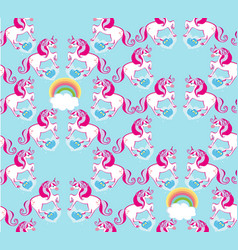 Seamless pattern with cute unicorns and rainbow vector