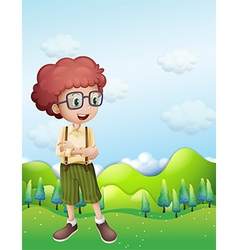 A boy standing across the hills vector