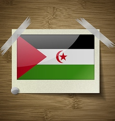 Flags western sahara at frame on wooden texture vector