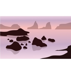 Silhouette of rock in beach vector
