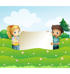 Two teens holding a wide empty signage vector image vector image