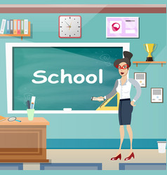 Young female teacher in class room vector