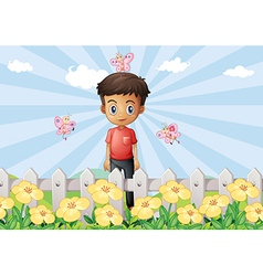 A boy in the garden with a fence vector image vector image