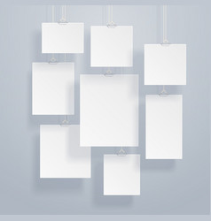 Blank white image and photo frames on wall vector