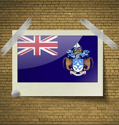 Flags tristan da cunhaat frame on a brick vector