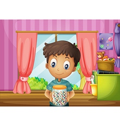 A young boy holding a jar of candies vector image