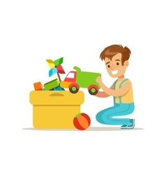 Boy Putting His Toys In Special Box Smiling vector image