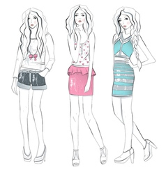 Young fashion girls in fashionable clothes posing vector
