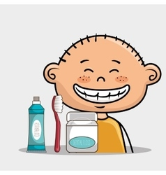 Smiling cartoon boy with dental care implements vector