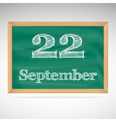 September 22 inscription in chalk on a blackboard vector