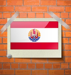 Flags french polynesia scotch taped to a red brick vector