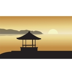 Silhouette of gazebo at sunset vector