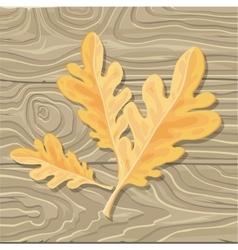 Oak leaf on wooden background vector