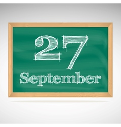 September 27 inscription in chalk on a blackboard vector