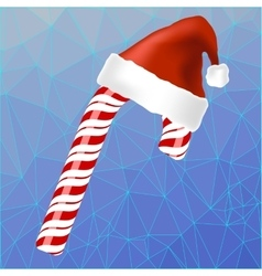 Sweet red candy cane and hat of santa claus vector
