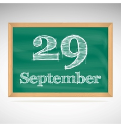 September 29 inscription in chalk on a blackboard vector