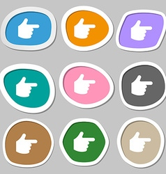 pointing hand icon symbols Multicolored paper vector image