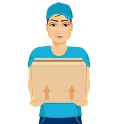 delivery man holding and carrying a cardbox vector image