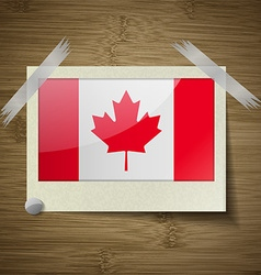 Flags canada at frame on wooden texture vector