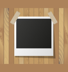 instant photo frame on wooden background vector image