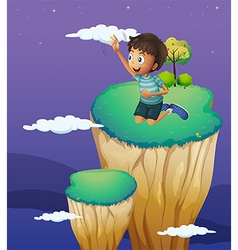 A boy reaching the cloud vector