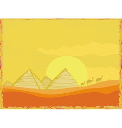 Old paper with pyramids giza and camels silhouette vector