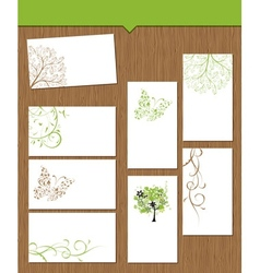 Set of floral cards on wooden background for your vector image