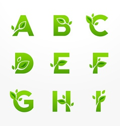 Set of green eco letters logo with leaves vector