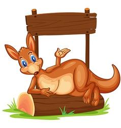 A kangaroo under the empty wooden signboard vector image vector image