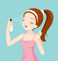 Girl Spraying Mineral Water On Her Face vector image